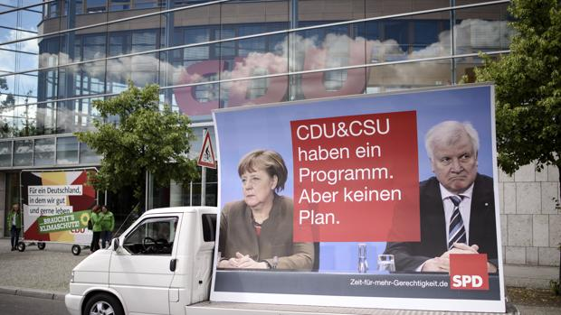 Merkel promete pleno empleo en 2025