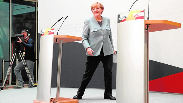 Merkel afronta la misión casi imposible de conciliar a viejos enemigos políticos