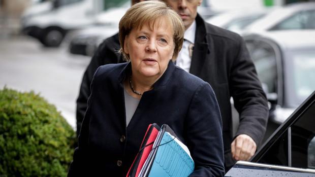 Angela Merkel, a su llegada a una reunión con sus posibles socios de gobierno