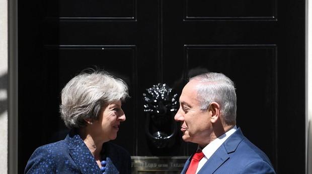 May dice a Netanyahu que Reino Unido seguirá apoyando el pacto con Irán