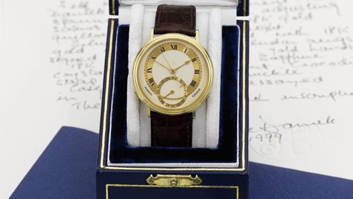 Reloj de oro amarillo automático con segundos centrales, fecha y escape Co-axial realizado en 1999
