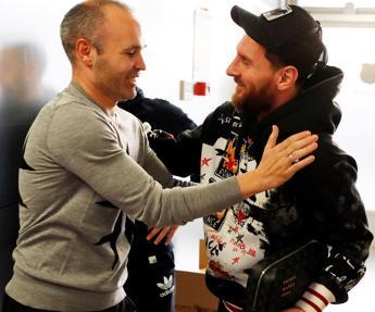 Andrés Iniesta junto a Leo Messi